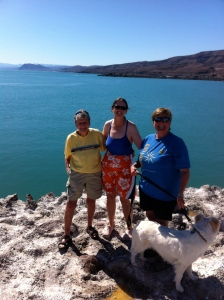Three friends and a dog overlooking the Sea of Cortez on the bluff